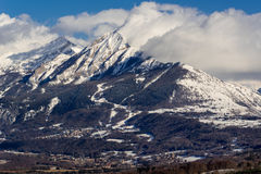 Petite and Grande Autane in winter, Champsaur, Alps, France. Petite and Grande Autane mountain peaks covered in winter snow. Saint Leger les Melezes, Champsaur royalty free stock image