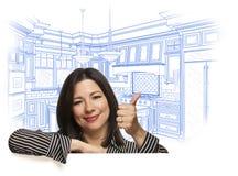 Petite Hispanic Woman Gives Thumbs Up, Over Custom Kitchen Drawing Stock Photo