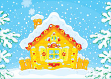 Petite hutte de rondin dans la neige Photographie stock