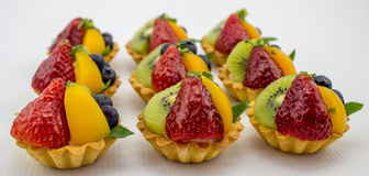 Petite Mixed Fruit Tarts Stock Images