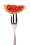 Petite pastèque sur une fourchette d'isolement sur le fond blanc Images libres de droits
