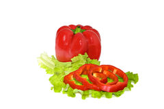 Petite red pepper and slices on a green leaf lettuce Stock Image