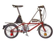 Petite roue de bicyclette rouge d'isolement sur un fond blanc avec l'agrafe Images stock
