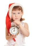 Petite Santa avec l'horloge d'alarme Photographie stock