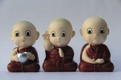 Petite sculpture en argile de moine Photos stock