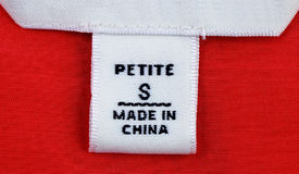 Petite-size clothing label. Close up view of the Petite-size clothing label royalty free stock photos