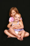 Petite soeur de grande soeur Photo stock