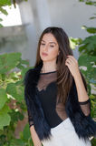 Petite young woman with very long hair wear bodysuits Stock Photography