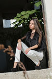 Petite young woman with very long hair wear heels and white pants Royalty Free Stock Images