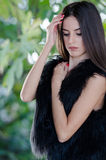 Petite young woman wear only her lamb fur vest Royalty Free Stock Image