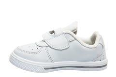 Petites chaussures de blanc de sport d'enfant Images stock