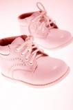 Petites chaussures roses Photos libres de droits