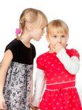 Petites filles partageant un secret Photographie stock