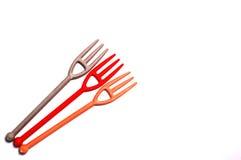 Petites fourchettes en plastique mignonnes Photo stock