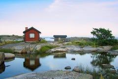 Petites huttes dans l'acrhipelago externe Photos stock