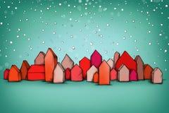 Petites maisons rouges dans la tempête de neige Images stock