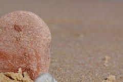 Petites pierres sur la plage Images stock