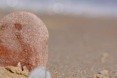 Petites pierres sur la plage Photographie stock libre de droits