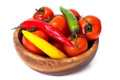 Petites tomates fraîches dans une cuvette Images libres de droits