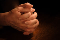 Petition. A man's hands folded in prayer Stock Photo