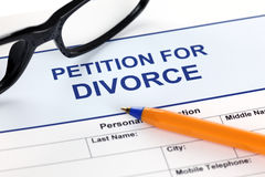 Petition for Divorce. With glasses and ballpoint pen Royalty Free Stock Image