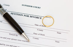 Petition for divorce paper. A composition of a petition for divorce paper a ring and a pen Royalty Free Stock Image