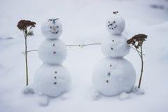 Petits bonhommes de neige mignons Photos libres de droits