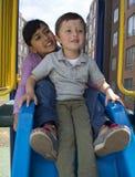 Petits childs sur la glissière Photographie stock libre de droits