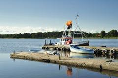 Petits dock et bateau Photographie stock