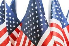 Petits drapeaux des Etats-Unis sur le blanc Photo libre de droits