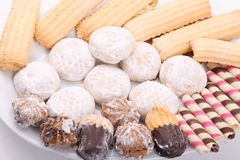 Petits fours, Biscuits and cakes. Cakes, biscuits, candies and petits fours presented in a dish Stock Photos