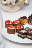 Petits fours. Plate with petits fours confectionery and appetizers Stock Photo