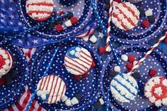 Petits gâteaux décorés pour le quatrième de la célébration de juillet Photographie stock