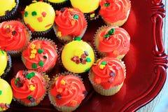 Petits gâteaux oranges et jaunes de thanksgiving images libres de droits