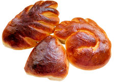 Petits pains de cannelle sur le fond blanc Photo libre de droits