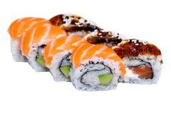 Petits pains de saumons et de caviar d'isolement sur le blanc Photo stock