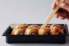 Petits pains du Japon de bâtons de mains Photographie stock