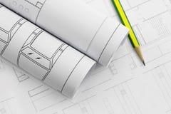 Petits pains et plans d'architecte, dessin de plan de construction et crayon Photographie stock