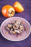 Petits poulpes décorés du caviar rouge Photos stock