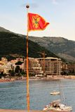 Petovac Montenegro june 2015 ,national flag over the sea stock photography