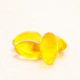 Petróleo de fígado de bacalhau omega 3 cápsulas do gel Fotos de Stock Royalty Free