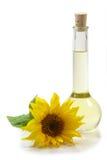 Petróleo de girasol con el flor Imágenes de archivo libres de regalías