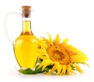 Petróleo de girasol con la flor Imágenes de archivo libres de regalías