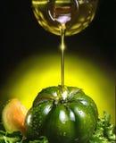 Petróleo verde-oliva e tomate Imagem de Stock