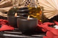 Petróleos essenciais da massagem do corpo Fotografia de Stock