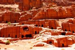 Petra. Ancient nabataean dwellings at Petra town, Jordan Stock Photos