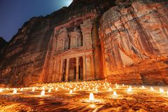 Free Petra By Night, Treasury Ancient Architecture In Canyon, Petra In Jordan. 7 Wonders Travel Destination In Jordan Royalty Free Stock Image - 135897826