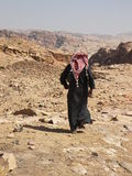 Petra, Jordan. Beduin man in archaeological site of Petra in Jordan surrounded by beautiful mountains Stock Photo