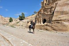 PETRA, JORDAN. APR 1, 2015: Nabataeans capital city Petra. Unidentified local man on a horse waiting tourist Royalty Free Stock Photos