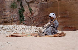 Petra, Jordan. Bedouin man playing traditional instrument Royalty Free Stock Images
